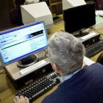 a man carrying out genealogy research online